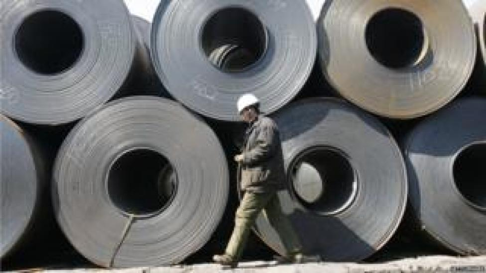A worker at a steel wholesale market in Liaoning Province, China