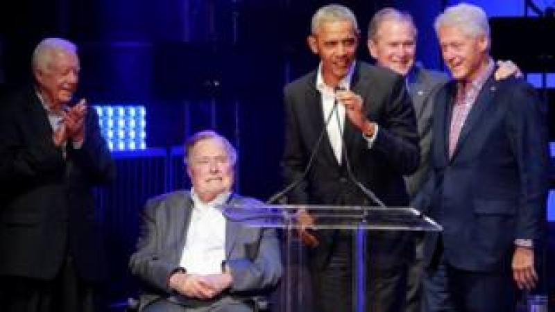 Five former U.S. presidents, Jimmy Carter, George H.W. Bush, Barack Obama, George W. Bush and Bill Clinton, speak during a concert at Texas A^M University benefiting hurricane relief efforts in College Station, Texas, U.S., October 21, 2017