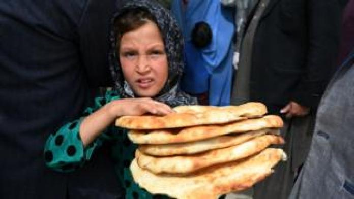 Food A young girl receives free bread from the municipality during Ramadan as the government-imposed a nationwide lockdown, in Kabul on April 29, 2020