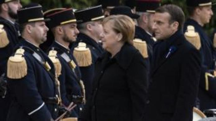 French President Emmanuel Macron and German Chancellor salute French soldiers as they attend a ceremony at the glaze of the Forest of Rethondes in Compiegne, France, 10 November 2018