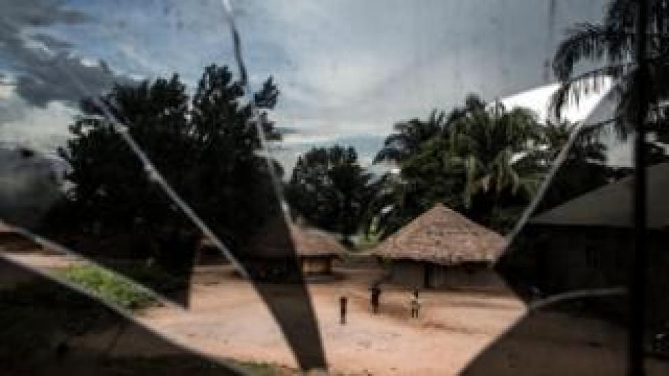 Three children seen through the broken window of a bus - Friday 10 May