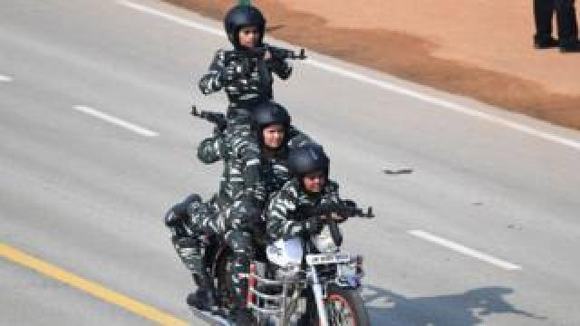 Central Reserve Police Force (CRPF) women motorcycle team members perform during the Republic Day parade in New Delhi on 26 January 2020.