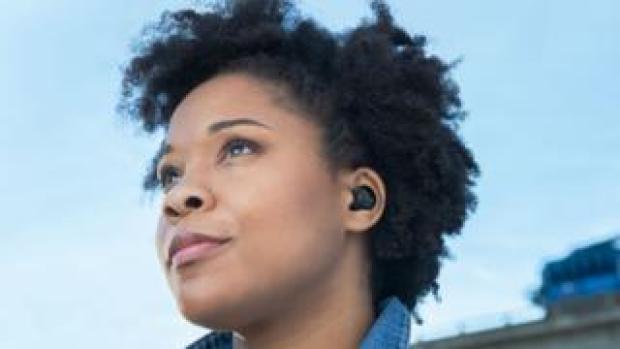 A woman wears Echo Buds