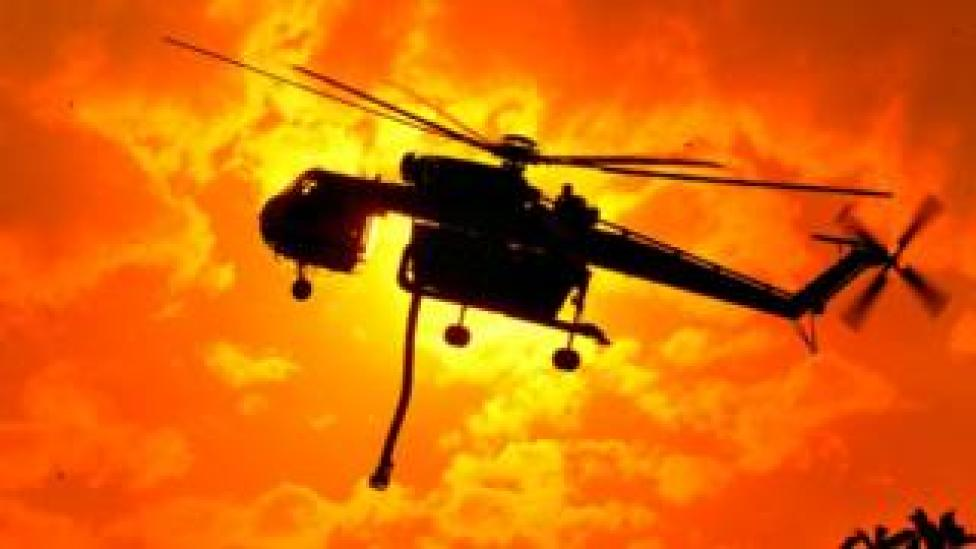 A helicopter prepares to fight bushfires in Victoria's Bunyip State Park
