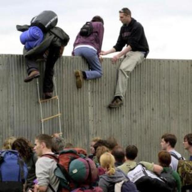Climbing over the fence in 2000