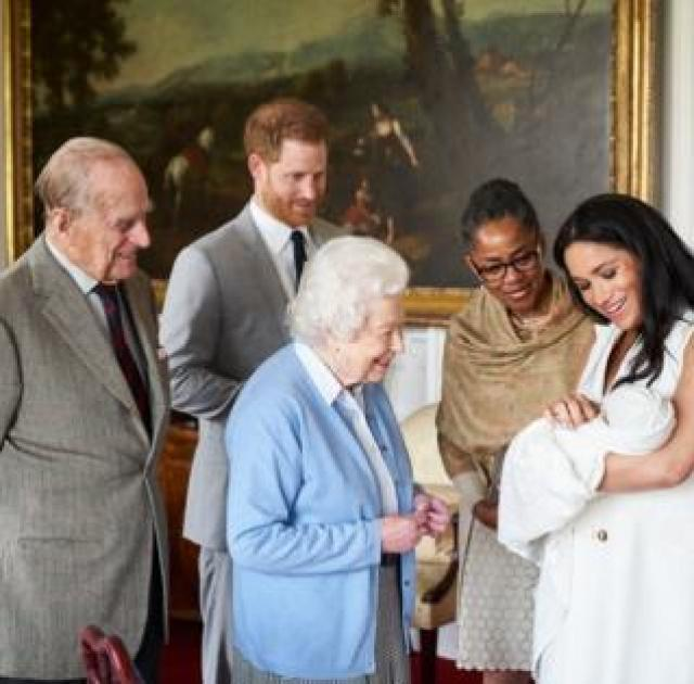 Prince Harry and his wife Meghan show their newborn son to the Queen and Prince Philip