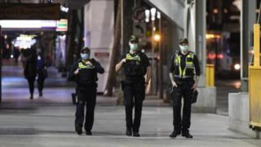 Officers patrol central Melbourne on 2 August 2020, after the curfew is introduced