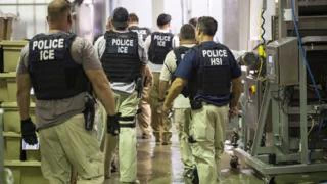 ICE agents at a raid in the US