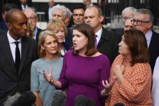 Liberal Democrat leader Jo Swinson speaks to colleagues