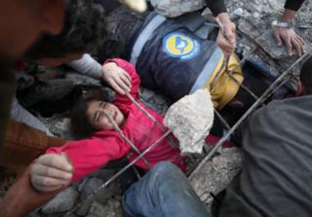 Girl being pulled out of rubble