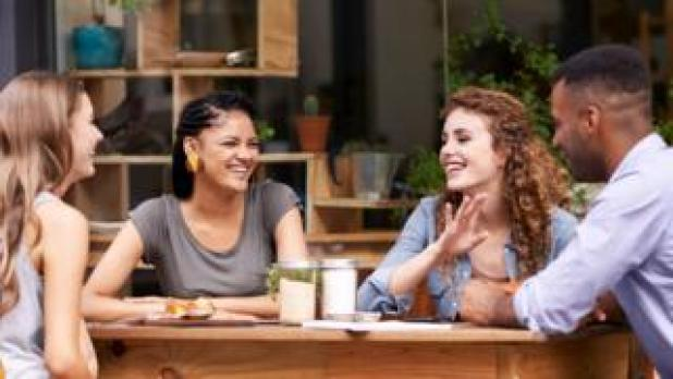 Young people chatting in a cafe