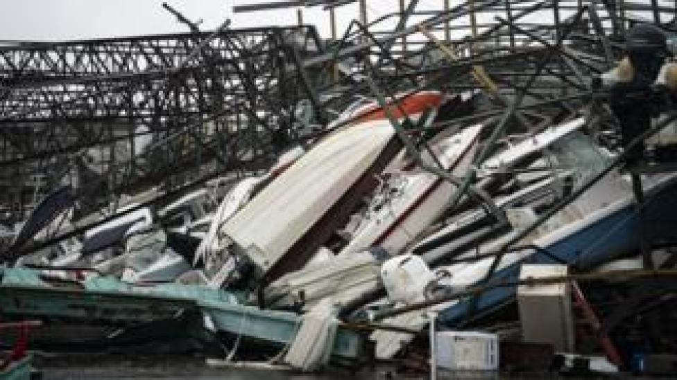 NEWS A warehouse of boats is damaged at Treasure Island Marina after Hurricane Michael made landfall along the Florida Panhandle, 10 October 2018