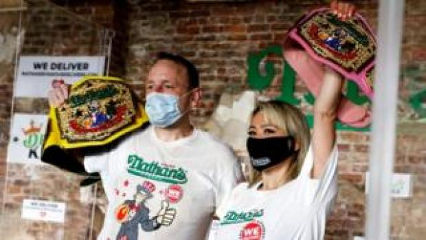 Champions of the 104th annual Nathan's Hot Dog Eating Contest, Joey Chestnut and Miki Sudo