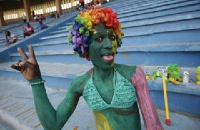 A Congolese fan cheers before the start of the 2019 AFCON group G qualifier match between Liberia and Congo at the Samuel Kanyon Doe Sports Complex in Paynesville, outside Monrovia, Liberia