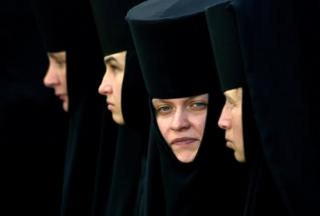 Orthodox nuns take part in a religious procession