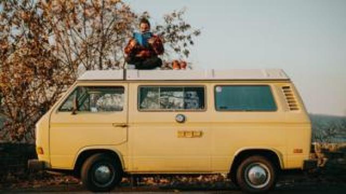 Grant Sabatier on top of his truck