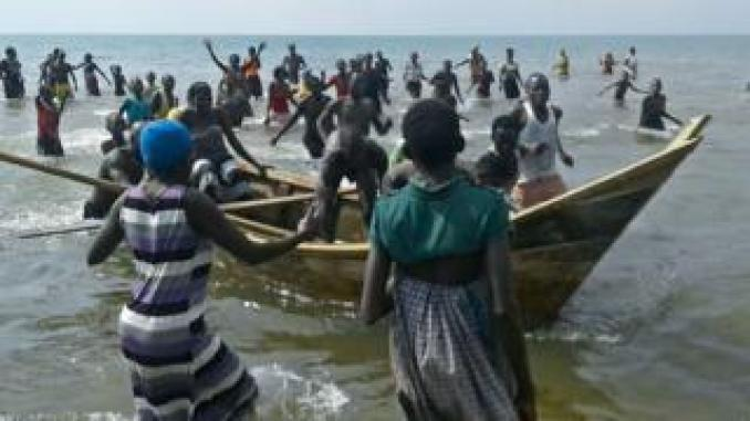 People in the lake rushing to the shore in December 2016