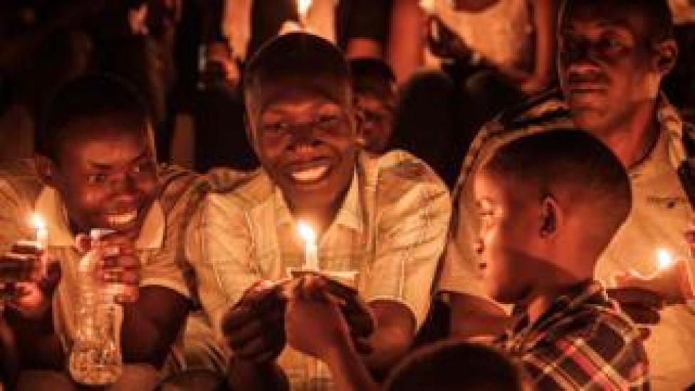 Children lighting candles during a night vigil and prayer at the Amahoro Stadium in Kigali, Rwanda - Sunday 7 April 2019