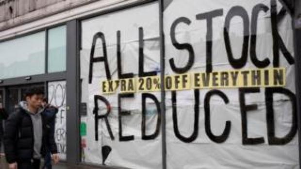 Shop with all stock reduced sign