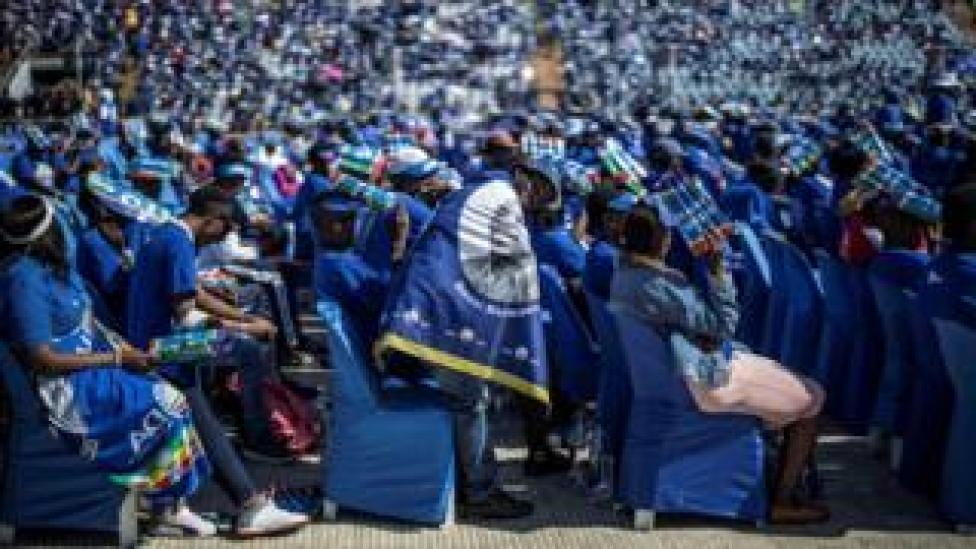 A supporter reacts as the South African opposition party Democratic Alliance leader delivers his speech during the final presidential election campaign rally of the DA at the Dobsonville Stadium, in Soweto, Johannesburg, on May 4, 2019.