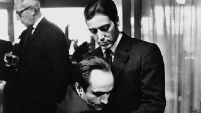 """Frederico """"Fredo"""" Corleone holds his brother Michael Corleone at a family funeral in Francis Ford Coppola's The Godfather: Part II"""