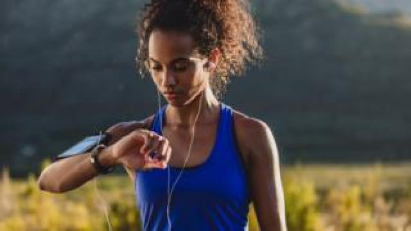 Woman checking fitness tracking watch