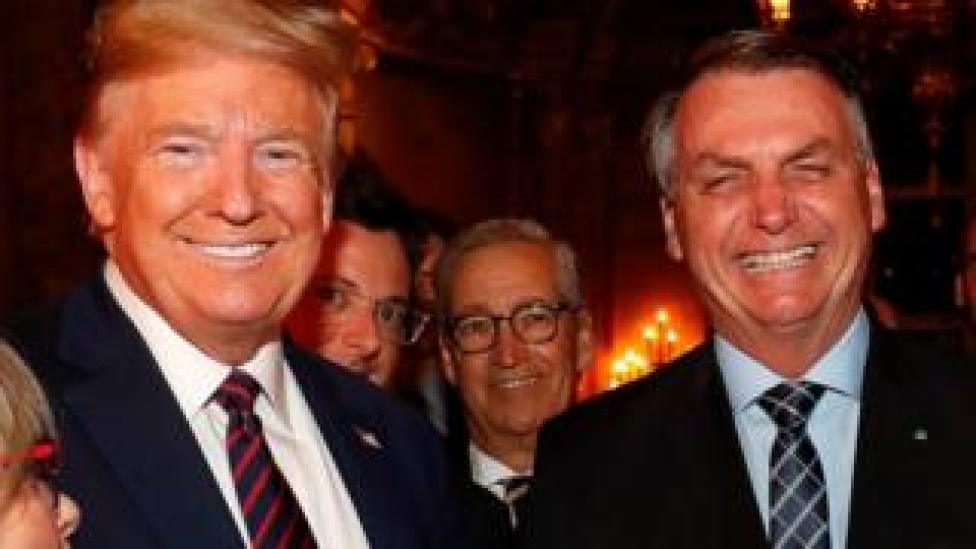 President Jair Bolsonaro (R), along with his Press Secretary, Fabio Wajngarten (2-L, partially obscured), during a meeting with US President Donald Trump (L), at the Mar-a-Lago residence in Palm Beach 7 March 2020