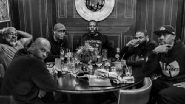 Wu-Tang Clan at a dinner table