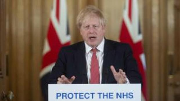 British Prime Minister Boris Johnson gestures as he speaks during a daily press conference at 10 Downing Street on March 20, 2020 in London, England. During the press conference, British Prime Minister Boris Johnson told pubs, cafes, bars, restaurants and gyms to close, whilst Chancellor Rishi Sunak announced that the government will pay up to 80% of the wages of those unable to work due to the coronavirus (COVID-19) crisis
