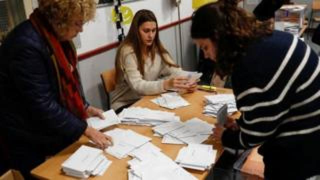 Members of an electoral commission count voting ballots