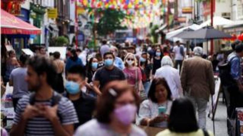 People walking through London's Chinatown