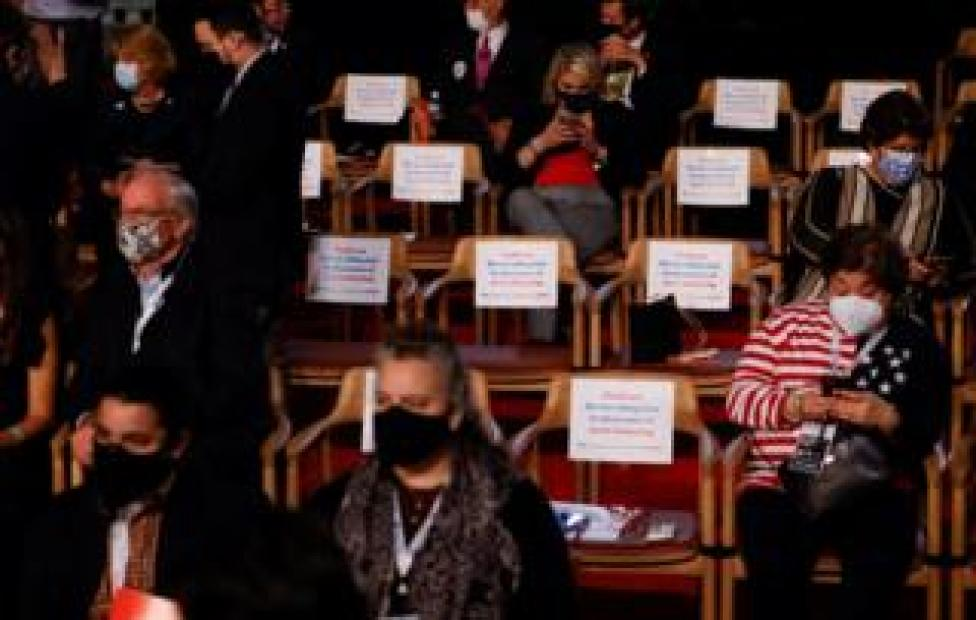 Audience members separated for social distancing wait for the start of the first 2020 presidential campaign debate