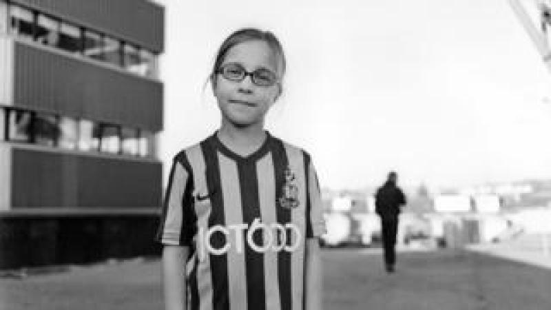 Young girl wearing football kit