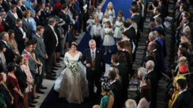 """Princess Eugenie walks down the aisle with her father, the Duke of York, for her wedding to Jack Brooksbank at St George""""s Chapel in Windsor Castle"""