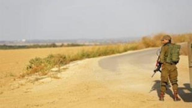 Israeli soldier watches the border with Gaza