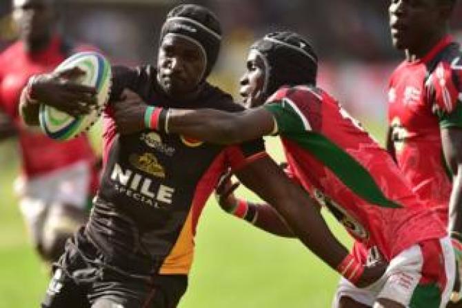 Uganda Cranes' Michel Okorach (L) attempts to fend off Kenya's Vincent Mose in a rugby match in Nairobi, Kenya - Saturday 7 July 2018
