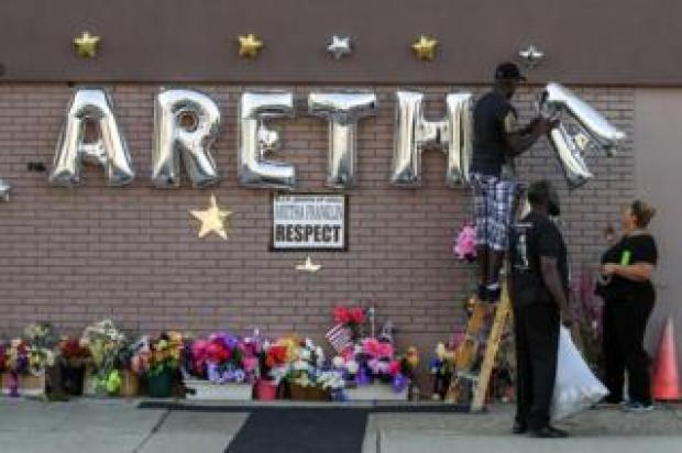 People work on a memorial for US singer Aretha Franklin outside the New Bethel Baptist Church before her body arrives for a public viewing in Detroit, Michigan, on 30 August 2018.