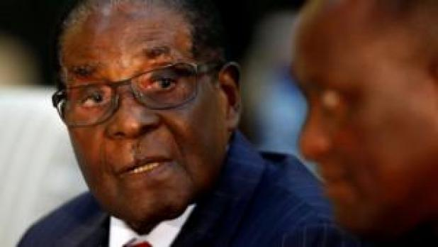 Robert Mugabe seen talking to another person