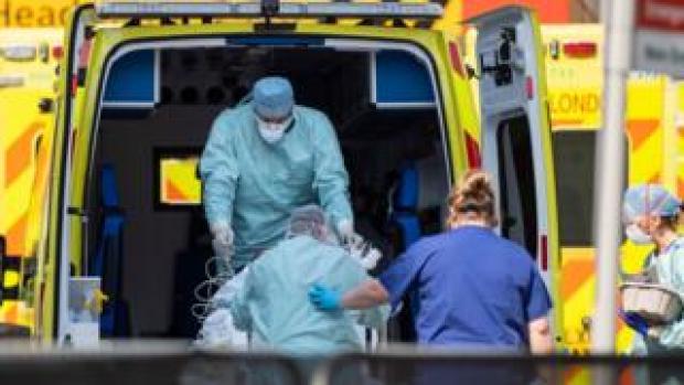 Patient entering an ambulance