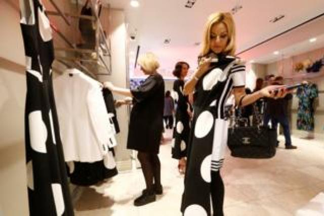 Women look at clothing in LK Bennett, Moscow