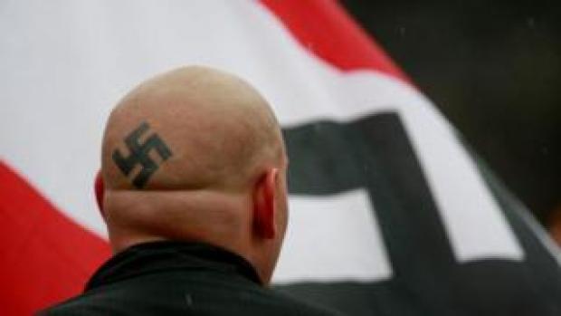 A white supremacist marches in Illinois in 2009