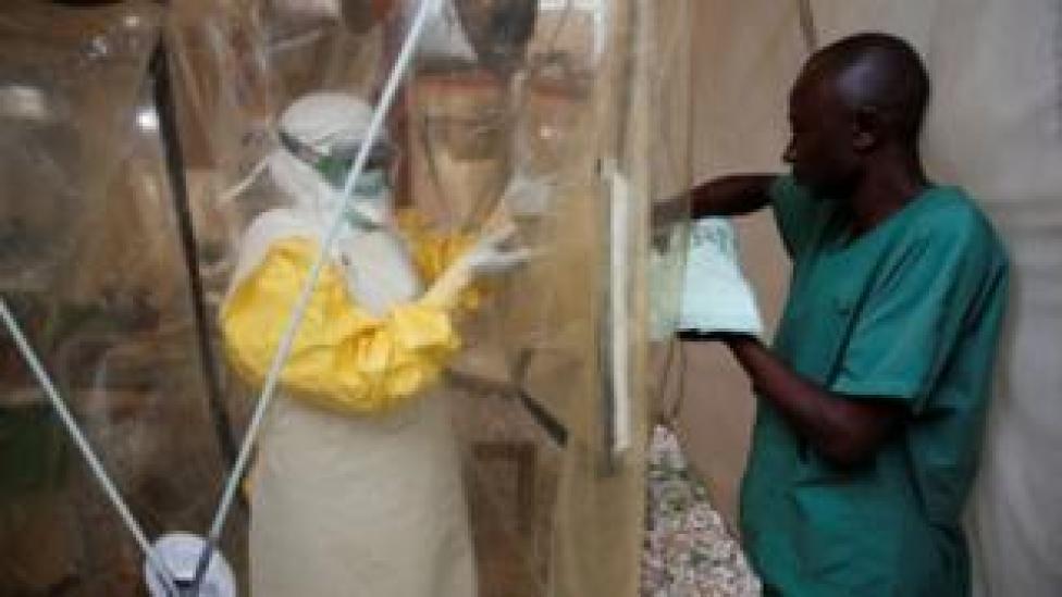 A health worker wearing Ebola protection gear enters Ebola treatment centre in Democratic Republic of Congo