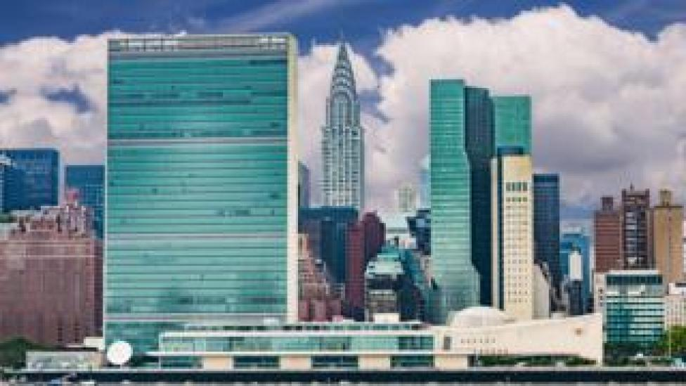 United Nations headquarters on New York skyline