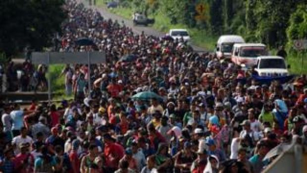 Honduran migrants take part in a caravan heading to the US on October 21, 2018