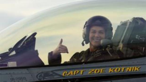"Capt Zoe ""SiS"" Kotnik sits in her fighter plane"