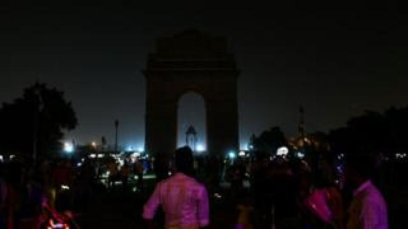 The landmark India Gate monument after the lights were switched off during the Earth Hour campaign in New Delhi.