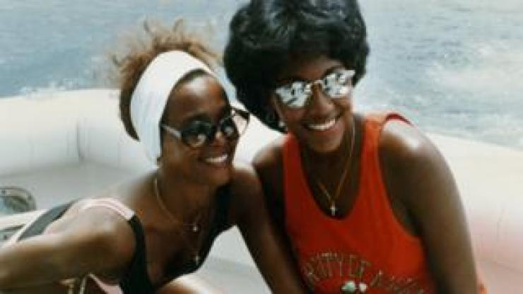 Whitney Houston (left) and Robyn Crawford relax on a yacht during a break on her 1987 Australian tour