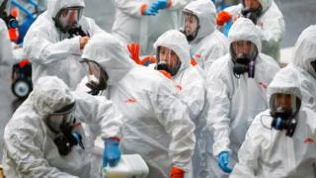 Members of a Servpro cleaning put on protective gear before entering the Life Care Centre of Kirkland, a long-term care facility linked to several confirmed coronavirus cases, in Kirkland, Washington, U.S