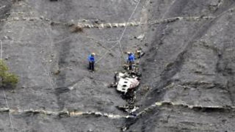 Members of the rescue team work at the crash site of the Germanwings Airbus A320 near Seyne-les-Alpes, France