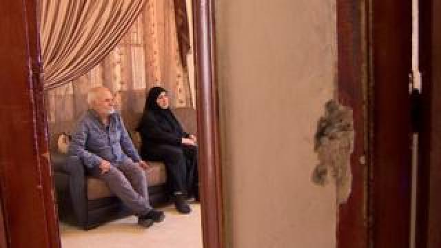 Parents inside house
